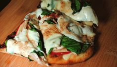 CHICKEN, APPLE and BLUE CHEESE PIZZA - A pizza crust is the best canvas for any piece of edible artwork around. You can use any and every kind of ingredient to create a pizza that will please every palate. This pizza combines the sweet apples and savory blue cheese for a twist on a popular spring salad.