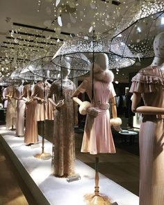 "LE BON MARCHE, Paris, France, ""When it rains, we share our umbrella, if we have no umbrella, we share the rain"", photo by Benjamin Raimondi. Visual merchandising. Retail store display. Women's clothing and accessories."