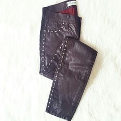 """Madewell Oxblood Studded Denim Get ready to turn heads with these 'to die for' Madewell studded skinny jeans! Front is lined with studs from hip to ankle. All over wax coated (leather like) in oxblood. From sample sale in NYC....did I mention one of a kind ?? Size 25. Measurements: 28"""" inseam, 12.5"""" waist, 8"""" rise. Worn twice, great condition. Listed on Posh only. 🚫 NO TRADE, HOLD OR DISCUSSION OF PRICE 🚫 Madewell Jeans"""