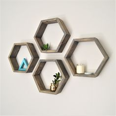 Small Hexagons in our weathered gray finish Diy Picture Frames, Hexagon Shelves, Small Potted Plants, Displaying Crystals, Shelves, Geometric Shelves, Pallet Picture Frames, Stud Walls, Hexagon Mirror