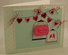 heart banners with bows; two birdcages with sentiment on  one