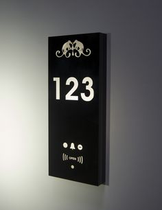 Hotel room number with Do Not Disturb and Make Up Room indicators