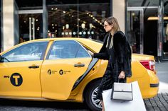 Heading home to get ready for the festive season with her timeless BOSS Bespoke bag