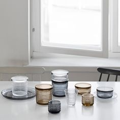 In 1964 Oiva Toikka's aim was to design a pattern that would conceal the joint marks in pressed glass. The result was Kastehelmi, Finnish for dewdrop, that features delicate glass droplets arranged in a series of rings. Jar Design, Kitchenware, Tableware, Decorated Jars, Vintage Pottery, Jar Storage, Glass Collection, Jewellery Storage, Elle Decor