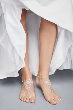 Skip the shoes and opt for this trendy crystal foot jewelry on your special day!  Crafted for the modern bride, this foot jewelry features sparkling crystal rhinestones draped in an elegant chandelier motif.  Imported.