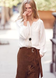 Behold, the one piece we have been waiting to wear all season. This luxurious suede skirt boasts a warm whisky-brown tone and a universally flattering wrap silhouette. One of our favorite outfits? A crisp white poplin blouse tucked into this skirt, cinched at the waist by its tonal self belt. | White House Black Market
