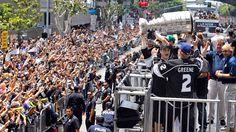 Los Angeles Kings' Matt Greene and teammate Dustin Brown hoist the Stanley Cup during a parade celebrating the team's NHL hockey Stanley Cup championship during a parade in Los Angeles, Thursday, June 14, 2012. (AP Photo/Jae C. Hong)