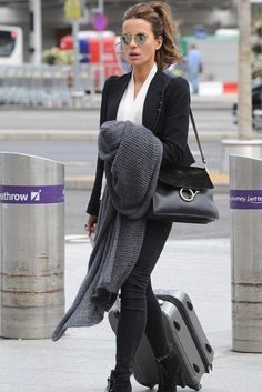 Kate Beckinsale in True Religion paired with a Chloe bag & Prada boots at Heathrow Airport in London. #bestdressed