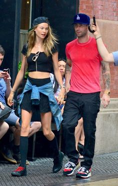 Adam Levine and Behati Prinsloo | Adam Levine and Behati Prinsloo New York City, New York - September 2, 2013. Maybe the rain could help wash her dirty hair.