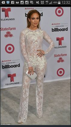 Jennifer Lopez Jumpsuit - For her Billboard Latin Music Awards look, Jennifer Lopez chose a sheer white lace jumpsuit by Zuhair Murad. Jennifer Lopez, Billboard Music Awards, Zuhair Murad, White Lace Jumpsuit, J Lo Fashion, Latin Music, Moda Plus Size, Red Carpet Looks, Lace Bodysuit