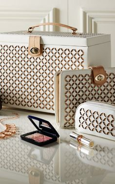 "As sophisticated as a designer ""It Bag,"" our Laser Cut Leather Jewelry Box is a must for the woman who wants to keep precious accessories safe and neat at home or on the road."