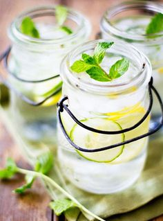 Brew a batch of H20 infused with lemon, ginger, cucumber, and mint to keep you hydrated and avoid holding onto extra inches of belly bloat. // #Health #Diet