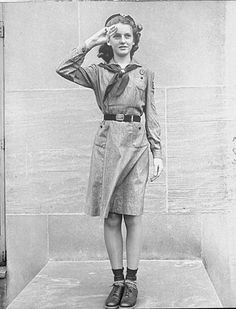 A Girl Scout saluting the flag using three fingers. Photograph by Alfred Eisenstaedt. New York City, Girl Scout Uniform, Girl Scout Troop, Girl Scouts, Scout Leader, Norman Rockwell, Saluting The Flag, Les Scouts, Charles Trenet, Scouting