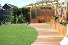 Circular lawned garden design - Eastbourne Gardens- with curved deck reinforcing the shape.