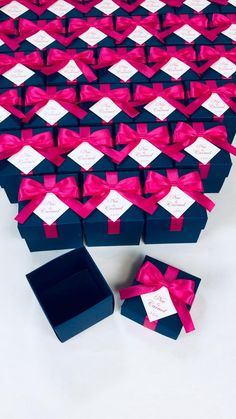 Navy blue wedding favor box with Hot Pink satin ribbon bow and custom names, Elegant bonbonniere. Personalized gift boxes make a unique way to thank guests for attending your special day. #giftbox #personalizedgifts #weddingfavor #weddingbox #weddingfavorideas #bonbonniere #weddingparty #sweetlove #favorboxes #candybox #elegantwedding #partyfavor #navybluewedding #bluewedding #giftboxes #uniqueweddingfavors #uniqueweddingideas #pinkwedding
