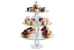 Simplicity Stacking Cake Plates  ARTLAND    $65.00  This three-tier pastry server is actually three separate plates, made of mouth-blown glass, that can be stacked or used on their own, providing versatility as well as elegance.