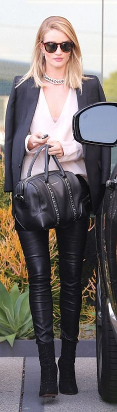 Rosie Huntington-Whiteley: Earrings – Anita Ko  Purse – Givenchy  Pants – Paige  Shoes – Alaia  Necklace and jacket – Saint Laurent