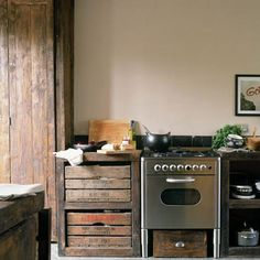 Reclaimed Style - love the tiny little stove with the old wood. I'd be afraid of getting splinters, though.