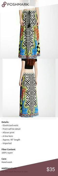 FLYING TOMATO | Bohemian Skirt Eye-catching pattern in a flowy silhouette is a must-have for every boho wardrobe...  * Elasticized waist * Front tie w/tassels * All-over geo pront in blue, orange  white and green  * 100% Rayon * Fits true to size * Excellent condition   Length 40.5"