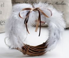 DIY idea: Give a new life to an old Christmas wreath by decorating it with feathers and a bow.