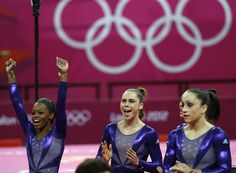 Gymnastics - Women's Qualifications - Gymnastics Slideshows | (From L) US gymnasts Gabrielle Douglas and McKayla Maroney react during the women's qualification of the artistic gymnastics event.  (Photo: Thomas Coex / Getty Images) #NBCOlympics