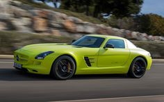 At 740-hp and 738-lb-ft, the Mercedes-Benz SLS AMG Electric Drive ranks as the most powerful production electric car on earth. Four separate motors draw energy from a 60-kWh lithium-ion battery pack that is the real star of the show.