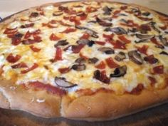 Delicious gluten-free pizza with homemade crust at The Gluten-Free Homemaker