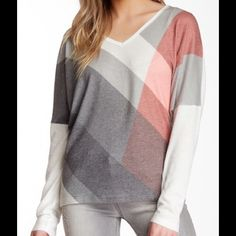 """Go Couture ivory Colorblock sweater - V-neck - Long dolman sleeves - Front graphic print - Approx. 25"""" length - Made in USA Fiber Content: 47% rayon, 47% polyester, 6% spandex Care: Machine wash Fit: this style fits true to size. Bundle for even bigger savings! Offers welcome. No trades. Go Couture Sweaters Crew & Scoop Necks"""