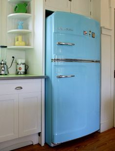 Want this but in red!!!  Frigidaire has these new appliances with the retro look but they are more energy and cost efficient.