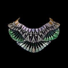 Pharaonic bib necklace from Carnet byMichelle Ong, incorporatinga lively green, lavender, yellow and fabulously icy pale jade in one magnificent piece.