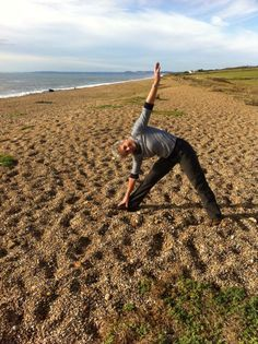 A Fantastic Triangle Pose taken on Sunday at Chesil Beach with Fiona. — at Chesil Beach.  www.bevsfitness.co.uk