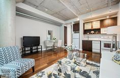 66 Portland Lofts-66 Portland St #206 | Ideal 530 sf 1 bedroom & 1 bath loft for 1st time buyers/investors or a pied-a-terre. Features 10 ft high exposed concrete ceilings, dark laminate floors & 2 large fluted concrete columns. | More info here: torontolofts.ca/66-portland-lofts-lofts-for-sale/66-portland-st-206 Concrete Column, Concrete Ceiling, Exposed Concrete, Dark Laminate Floors, High Windows, Window Wall, Lofts, Columns, Investors