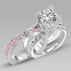 Glamour Girl  - The uniquely detailed engagement ring boasts high quality cz stones at the top of each claw on the setting cradling a large solitaire, one in the middle where the bands meet, and multiple cz's all along the 18k white gold filled band. Next comes the wedding band. The pink princess cut stones lay in a channel setting and are met in the middle with 4 cz's. When slid between the bands of the engagement ring, it looks like one #alternativeweddingrings #shopcloverkitty #wedding
