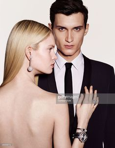 Models pose at a fashion shoot for Madame Figaro on February 12, 2015 in Paris, France. Female model: Boule earring and Allegra ring (De Grisogono), Force 10 watch (Fred), Life For Ever watch (Mauboussin). Male model: All (Saint Laurent par Hedi Slimane). PUBLISHED IMAGE.