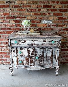 turquoise knobs and a distressed shabby white dresser, painted furniture, repurposing upcycling, Nashville Flea Market find Paint and Turquoise Knobs make for a cool makeover
