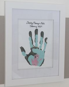 Dad, mom and baby handprints! What a sweet idea. (Great blog too!)