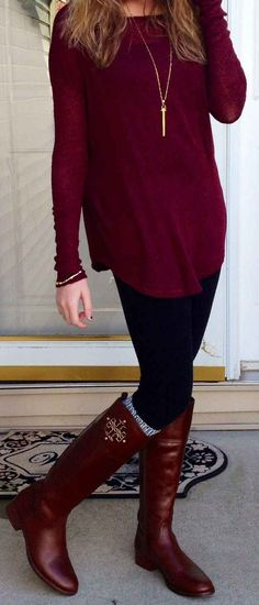 Burgundy top, black leggings, high socks, gold bracelet and riding boots