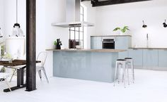There's one look our editors agree isn' going anywhere: industrial design. Here's how to re-create the hip loft look and warehouse style at home. Blue Kitchen Cabinets, Glass Kitchen, Kitchen Decor, Smeg Kitchen, Kitchen Ideas, Decor Interior Design, Interior Decorating, Light Blue Kitchens, Kitchens