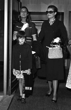 London, England, 10th September 1971, Princess Grace of Monaco wearing sunglasses and black coat in london with her daughters Princess Caroline, aged 13, and Princess Louise (aged 7).