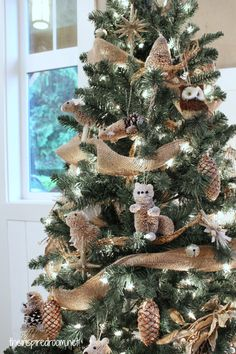 woodland-animal-ornament-christmas-tree-theme... I LOVE this! I think this is what our tree is going to resemble this year.