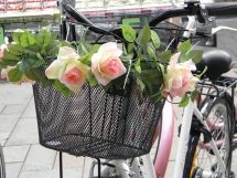 The basket should be wooden but the flowers around it are right.