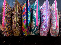 GO SHOP: www.novamelina.com  International shipping!  Liberty pf London fabrics, unique design products, boho scarfs, pouches, lanyards, softies, accessories, all things pretty!  #libertyoflondon #libertyprint #pouch #neon #tassel #unique #handmade #finnish #design #artgallery