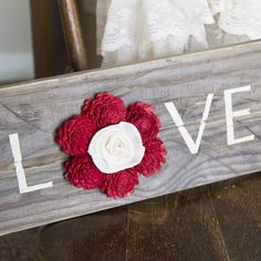 """Choose your own color! White washed pallet wood with the word """"Love"""" is completed by adding our beautiful sola wood flowers.  18inches X 7 inches. Includes"""