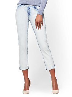 A faded wash complements the laid-back vibe of our most-loved Boyfriend jeans, accented by polished silvertone hardware. Get the look exclusively at New York and Company.