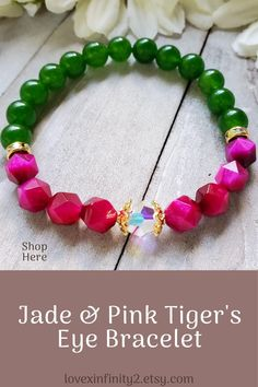 New to my shop! I absolutely love this beautiful green jade and pink tiger eye bracelet made with 8mm dark green chinese jade gemstones, 8mm faceted pink tigers eye beads, Swarovski AB bead, and rhinestone rondelles. Stretch Bracelet.  In Feng Shui, jade has been used for many centuries for its abilities to create a serene feeling of harmony and balance. Jade is also used for protection and for good luck. It is said to bring wealth, prosperity, and abundance. #jade #jadejewelry #tigerseye