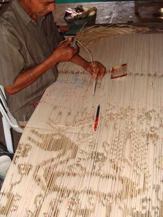One of the many steps in the process of making Ikat. Sumba Island. Eastern Indonesia