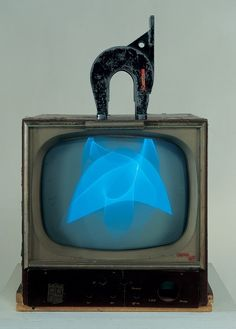 Nam June Paik, Magnet TV, 1965. 17-inch black-and-white television set with magnet, 28 3/8 × 19 1/4 × 24 1/2 in. (72.1 × 48.9 × 62.2 cm) overall. Whitney Museum of American Art, New York; purchase with funds from Dieter Rosenkranz  86.60a-b  © Nam June Paik Estate