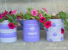 I'm seriously going to have to start asking for coffee cans from friends!  How cute is this? http://homeandgarden.craftgossip.com/recycled-cans-hanging-planters/