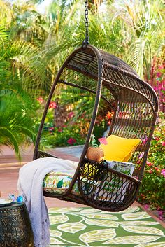 Hippy, happy and fun? Sure thing. But also durable and downright practical. After all, Pier 1's outdoor Swingasan® features an airy, open-weave back, side compartments for your drink and a canopy that provides cool, cool shade. All in all-weather wicker that's been woven by hand over a sturdy, rust-resistant iron frame. Groo. Vee. Chair stand available separately.