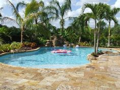 I would LOVE to someday see this type of pool & landscaping in my backyard!